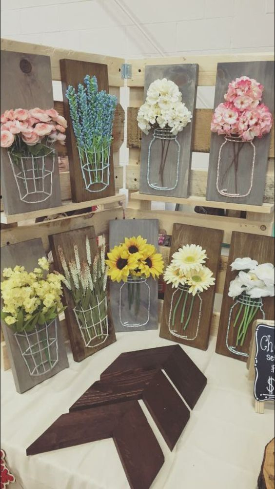 Craft a Mason Jar String Art with Wood, Yarn and Faux Flowers.