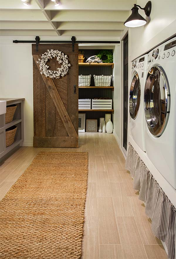 A Sliding Barn Door Adds to The Coziness of This Laundry Room.
