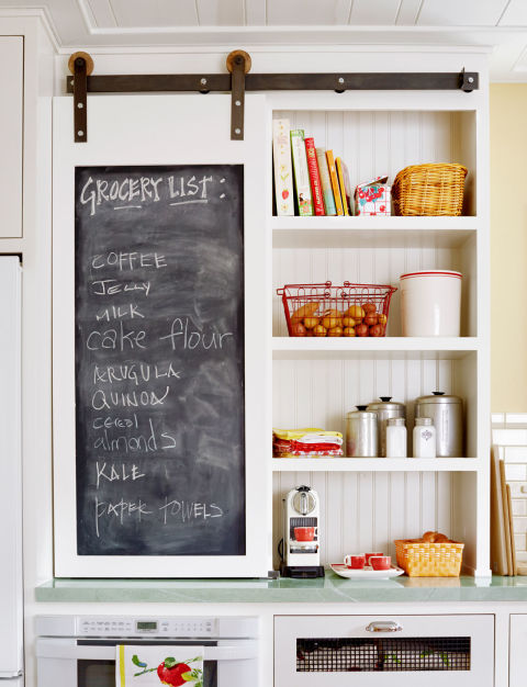 Chalkboard Barn-Style Cabinet Door for Keeping Track of Grocery Lists.