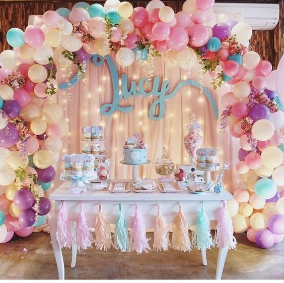 Gorgeous Balloon Arch and Tassel Garland Decorated Table.