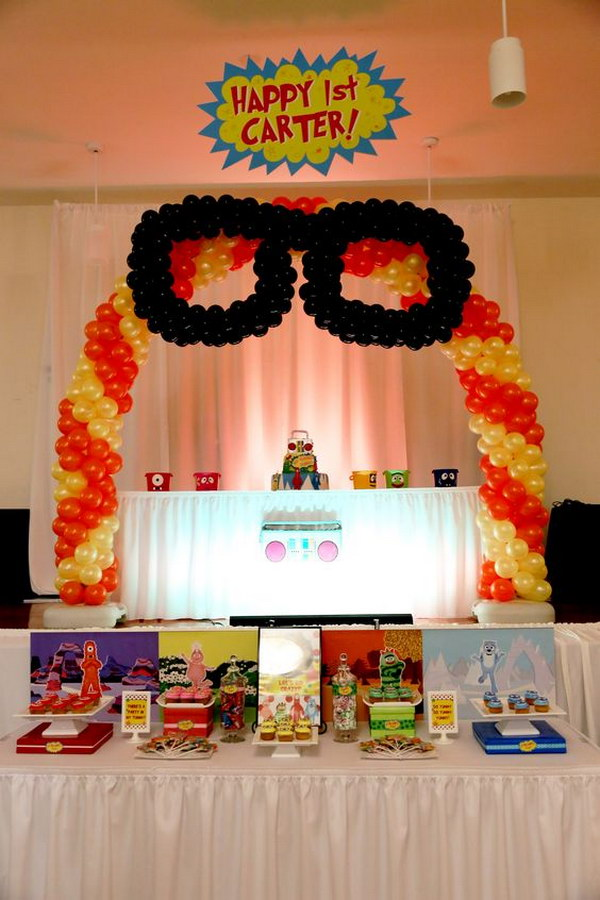Yo Gabba Gabba Cake and Desert Table under Balloon Arch.