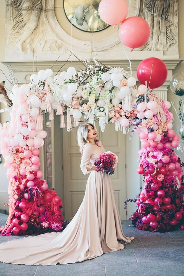 Whimsical pink to White Ombre Wedding Arch.