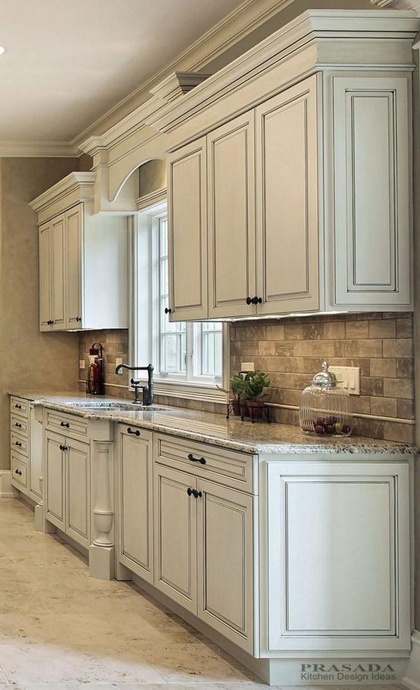 Classic Off White Kitchen With Granite Countertop.