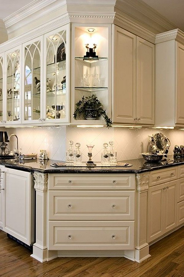 Gorgeous White Kitchen Corner With Black Countertops.