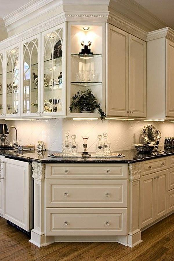 Gorgeous White Kitchen Corner With Black Countertops.