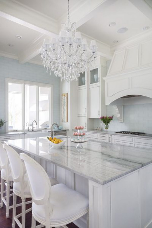 Sea Pearl Quartzite Kitchen Island Countertops With White Cabinets.