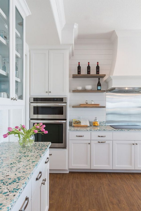 Recycled Glass Countertop With White Cabinets.