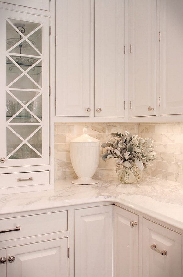 Calacutta Gold Marble Countertops With Chic White Cabine.