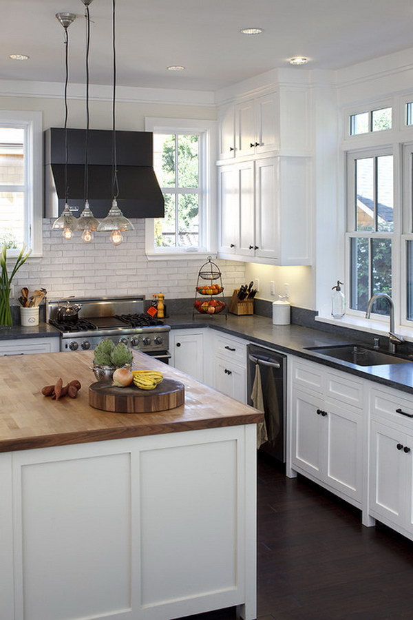 White Cabinets with Black Soapstone Countertops and Butcher Block Wood Island Countertops.