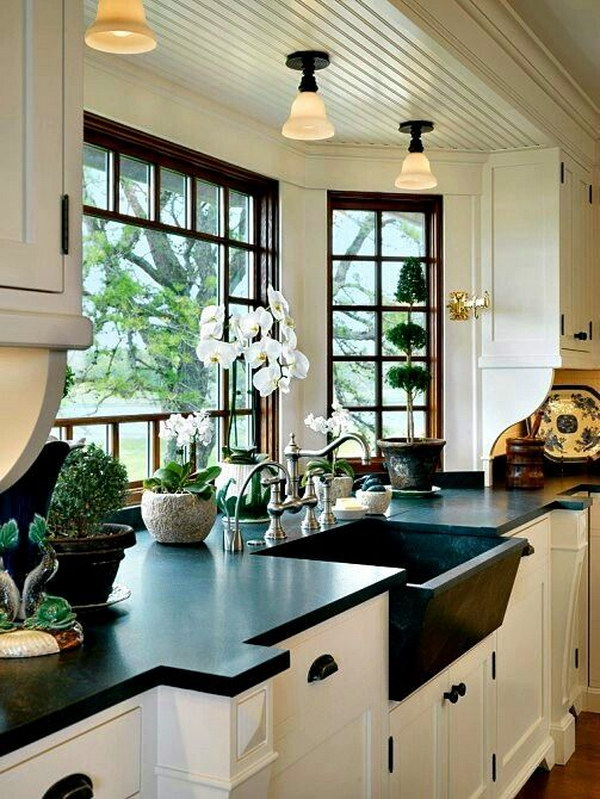 White Cabinets with Black Natural Honed Soapstone Counter and Kitchen Bay Window.