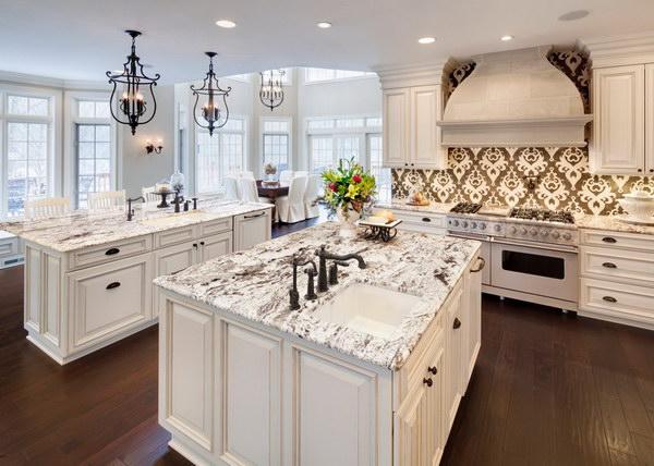 Luxurious All White Kitchen With Graphic Backsplash and White Carrara Granite Countertops.