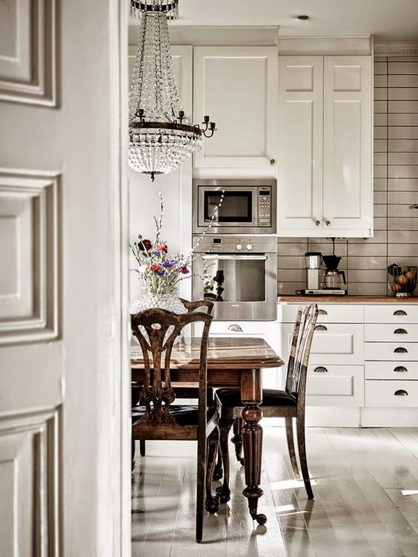Cool Feminine Chic Kitchen with Wood Countertops.