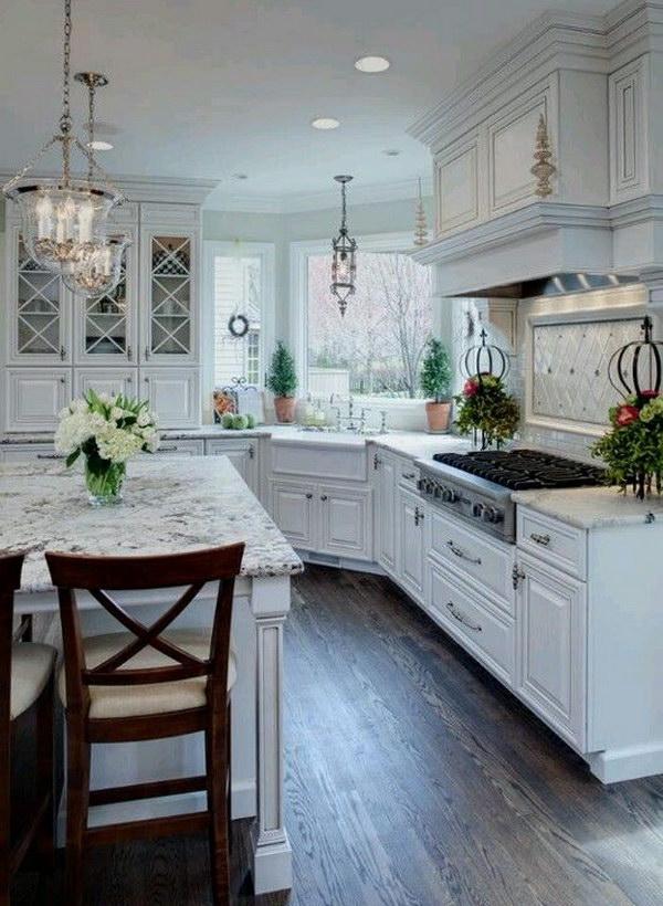 White Transitional Kitchen With Snow White Granite Countertops.