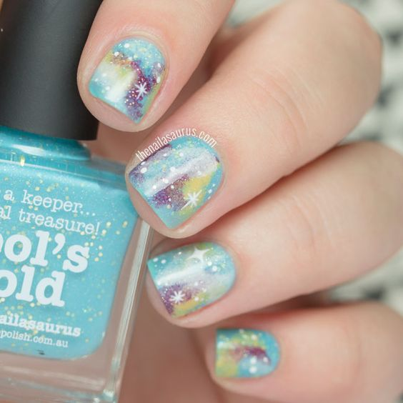 Turquoise Glittery Galaxy Nails.