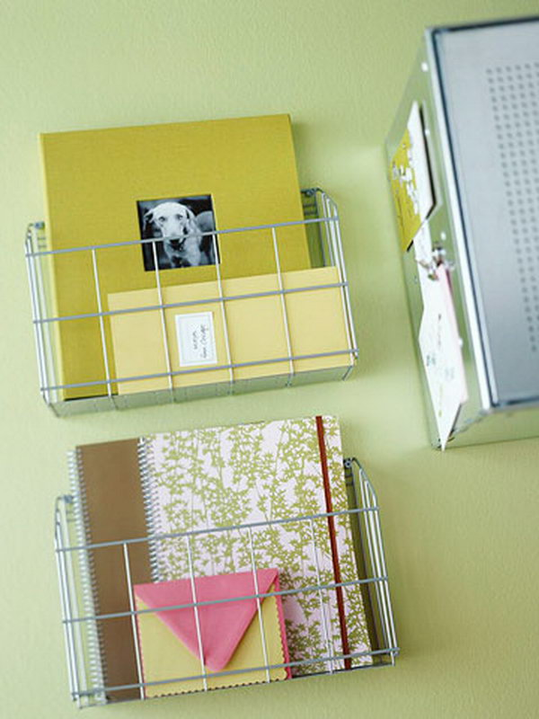 Kitchen wire racks are used in the home office as wall-mounted notebook holders.
