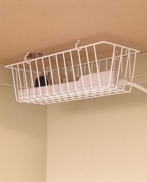 Take advantage of the under desk space by hanging a basket under the desk to keep cords off the floor.