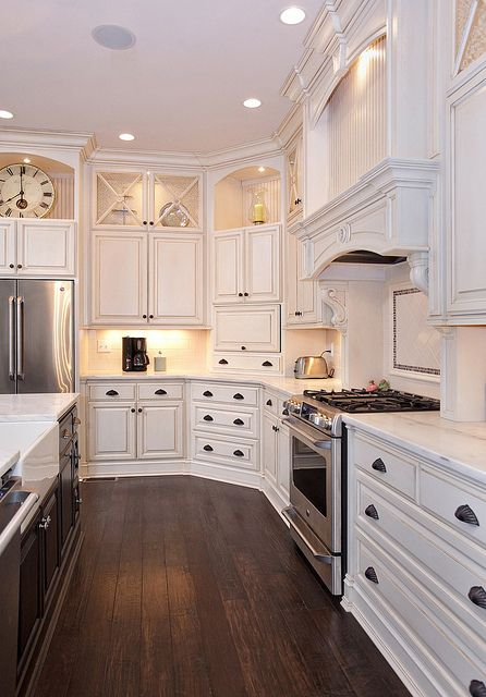 Great Contrast of White Kitchen Cabinets and Dark Wood Floors.