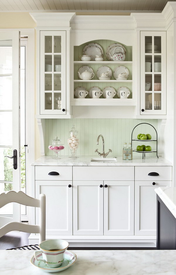 White Kitchen Cabinets Pared with Sage Green Backsplash.