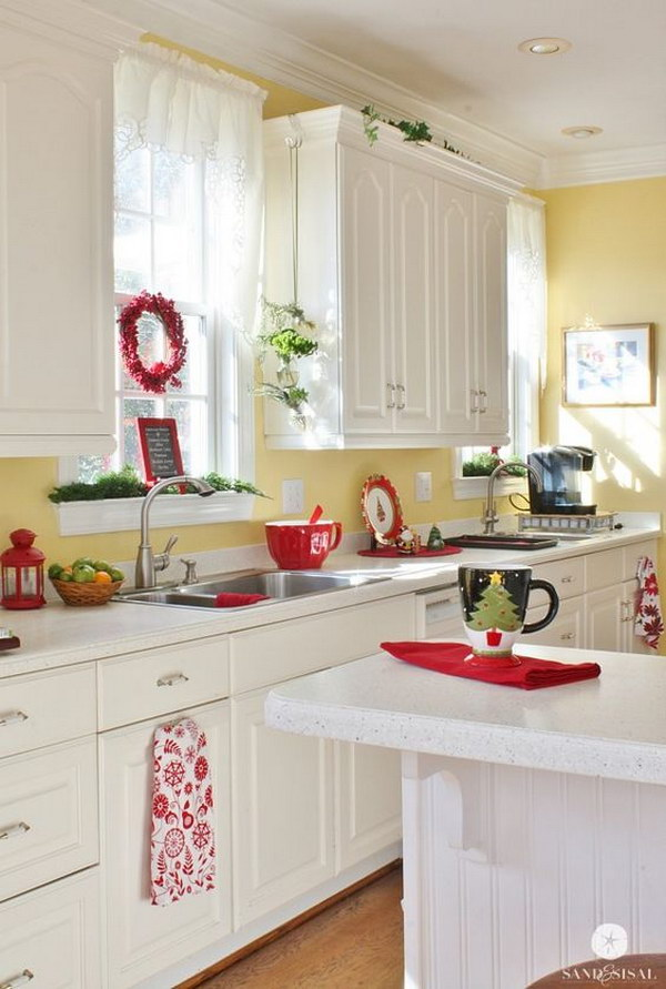 Cream White Kitchen Cabinets Paired with Soft Yellow Walls.