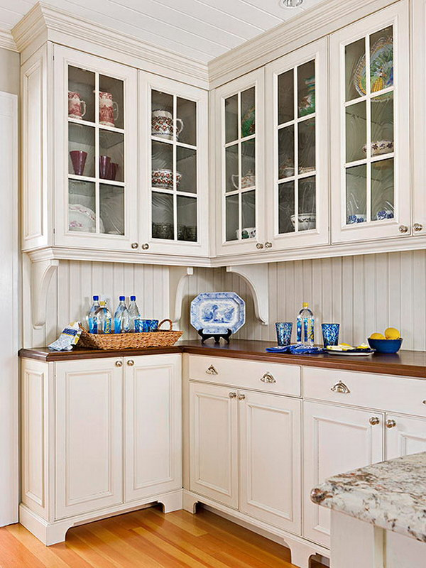 Cream White Kitchen Cabinets with Warm Wood Countertops.
