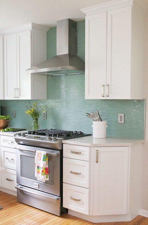 Snow White Cabinets Paired with Turquoise Backsplash.