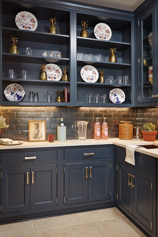 Dramatic Navy Blue Open Cabinetry with a Graphite Black Splash.
