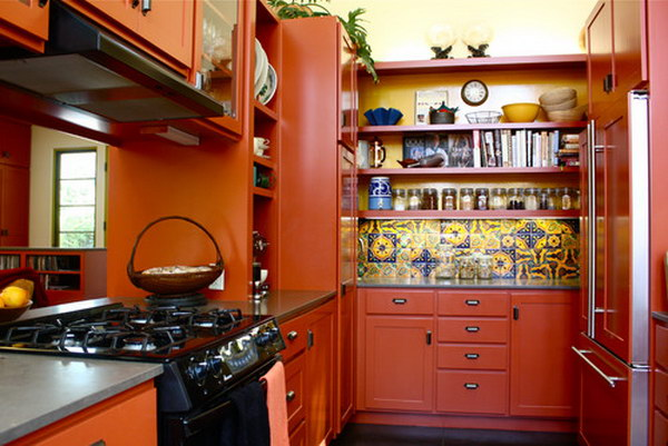 Rich Red-Orange Open Cabinets With Multicolored Backsplash And Paneled Appliances.