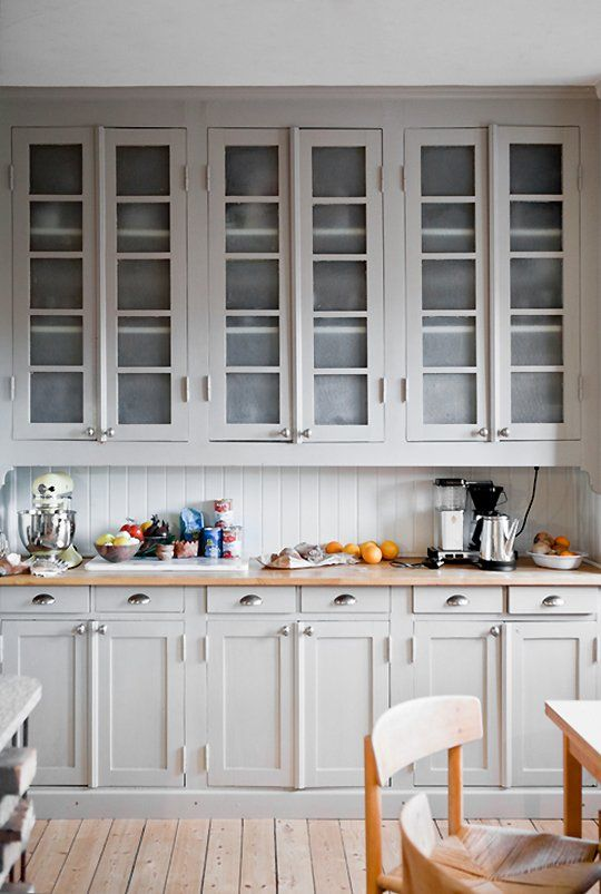 Warm Light Gray Cabinets With Subway Tile on The Backsplash.