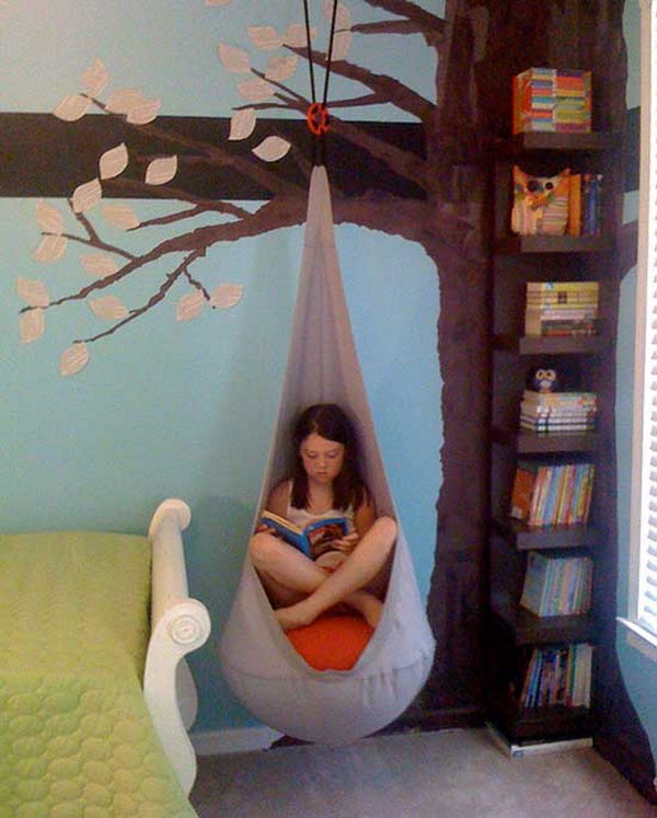 Reading Nook With Cocoon Hanging from the Book Shelf Designed like a Tree
