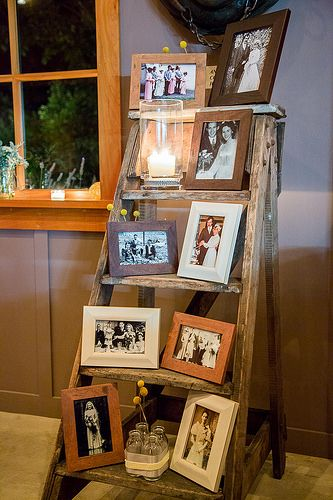 Use Old Rustic Ladder to Display Pictures for Your Rustic Living Room Theme.