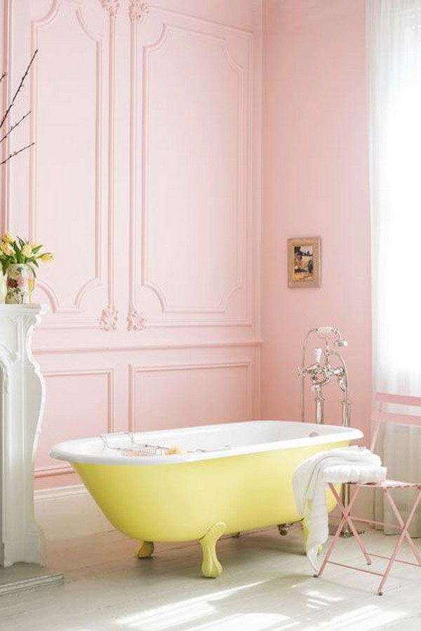 Pink Bathroom With Yellow Roll-Top Bath