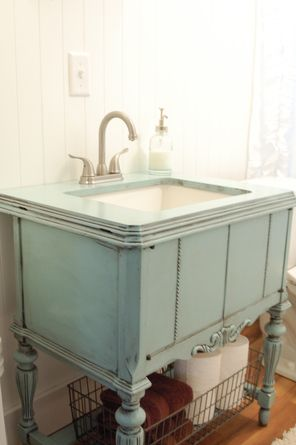 A Repurposed Sewing Machine Cabinet Is Now A Shabby Chic Bathroom Vanity.