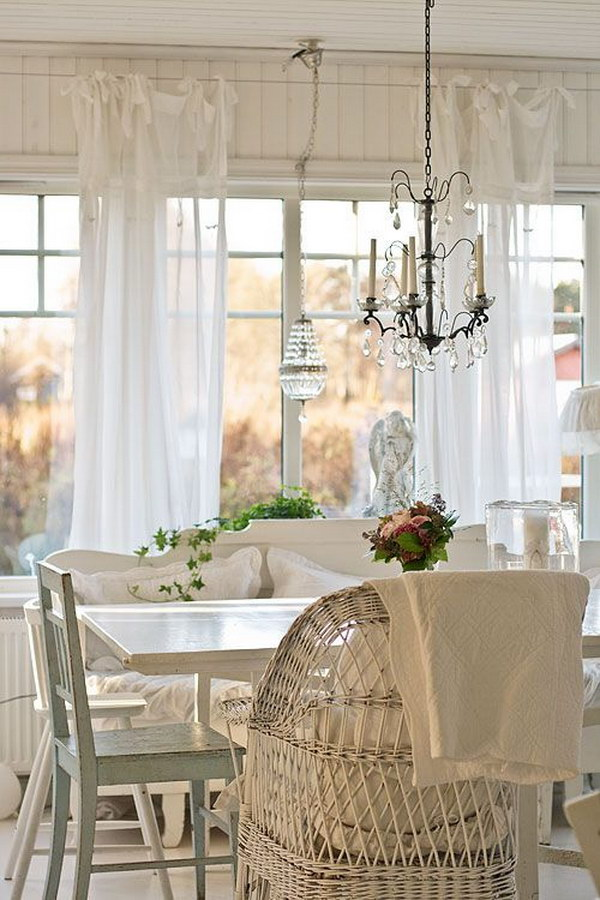 Shabby Chic Dining Room With White Curtains and Beautiful Chandeliers.