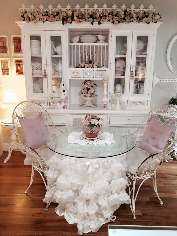 Lovely Shabby Chic Dining Room with White Hutch and a Glass Table Decorated with Cute Ruffled Tablecloth