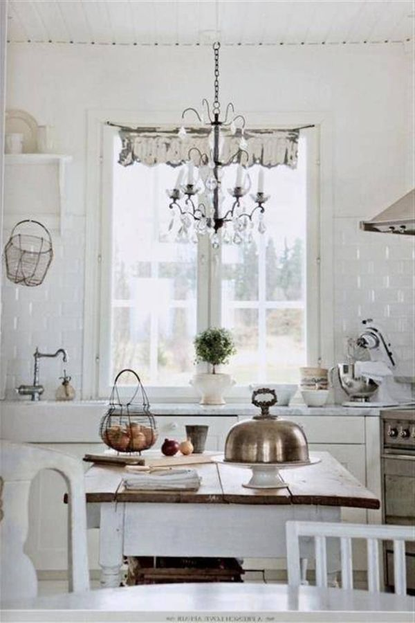 Shabby Chic White Kitchen With Chandelier Lighting Fixture.