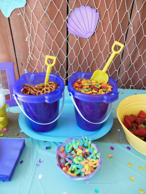 Sand Pails Filled With Snacks For Ocean Party.