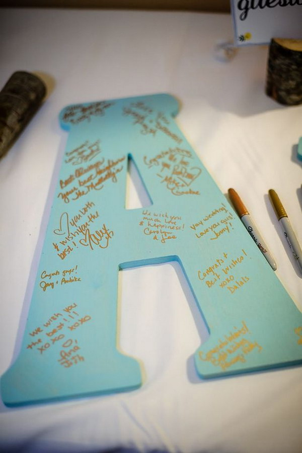 Have guests write their well wishes on large wooden initials.