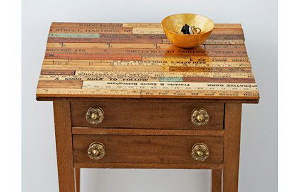 Vintage Ruler Table. Transform a tired side table into a master piece by covering the top in vintage rulers. Check out the tutorial