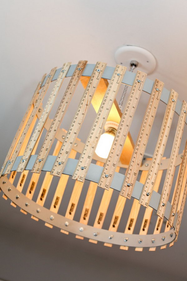 DIY Ruler Chandelier. Both functional and decorative accent to your home. Do you want to own one?
