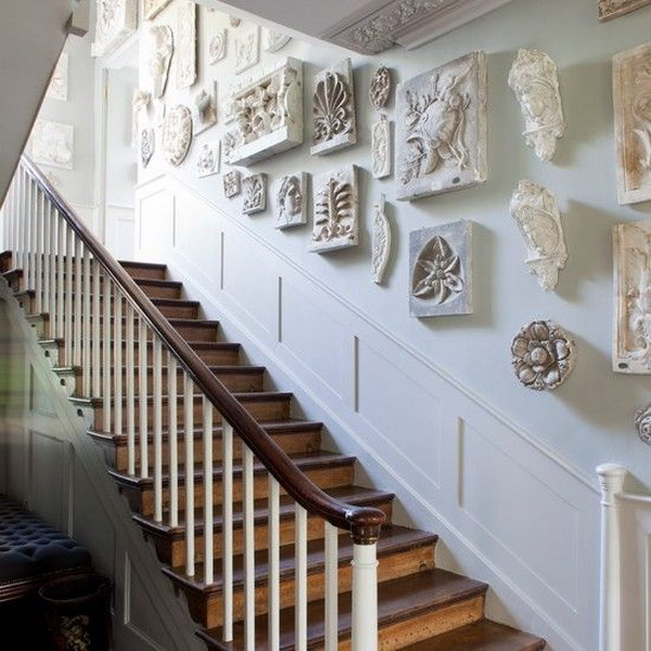 striking sculptures  give this regency-inspired hallway timeless appeal.