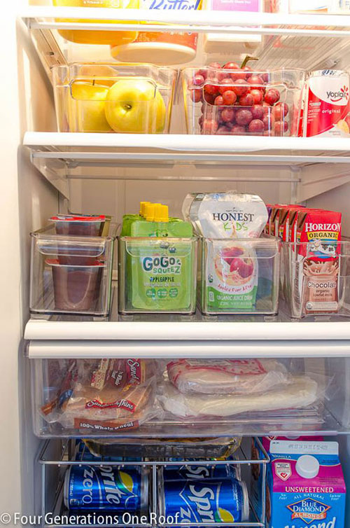 Organize your fridge with clear bins.