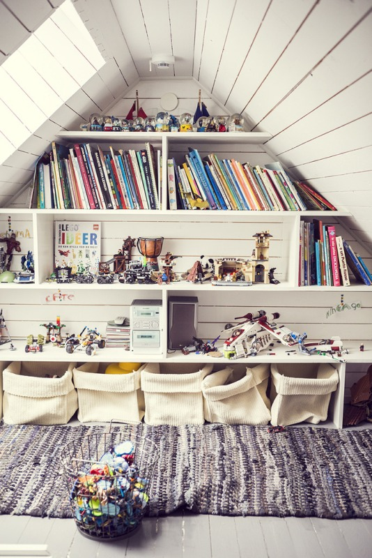Create a Wall Library to Store and Display Your Child's Books in the Attic Room.